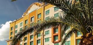 orlando hotel exterior with a palm tree