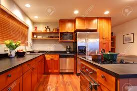 Kitchen With Hardwood Floor Really Nice Kitchen With Cherry Wood And Hardwood Floor Stock