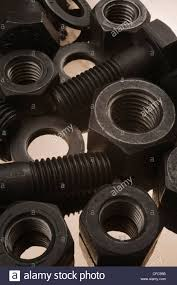 Large Washers Large Black Steel Bolts Nuts And Washers On Tin Foil Background