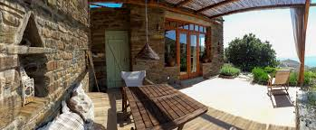 Small stone house Contemporary In Tinos And Using Stones That Were Extracted From The Plot Or Come From The Local Quarries The Interior Decoration And Building Of Furniture Tinos Eco Lodge The Small Stone House Tinos Eco Lodge