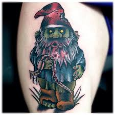 evil spectacular gnome eating earth worm tattoo