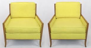 pair of bleached walnut and cane sided club chairs covered in canary yellow haitian cotton
