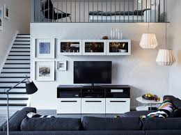 White Living Room Cabinet Display With Some Bright Pops Of Colour Breathaking Living Room