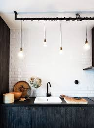 exposed lighting. in this scandinavian kitchen wires are shamelessly entwined on a rod look sometimes exposed lighting mydomaine