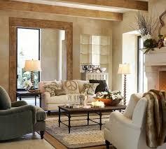 pottery barn white sofa gray sofa coffee table layered rugs table lamp standing lamp cream wall