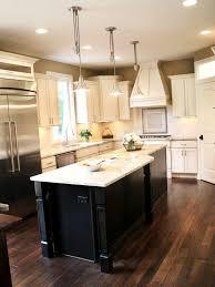Dark Wood Floors With Cream Cabinets And Dark Island Green Painted