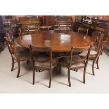a beautiful dining set prising a regency revival jupe style dining table and the matching set