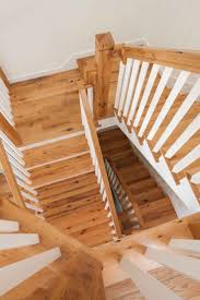 Reclaimed red and white oak stair treads custom milled by Longleaf Lumber  for an Otisfield,