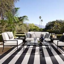 A Striped White And Black Indoor Outdoor Carpet