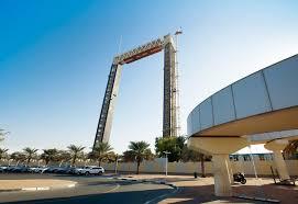 dubai munility s dubai frame consists of a pair of 150m tall concrete legs and a 93m long steel bridge