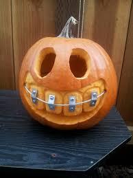 dremel pumpkin carving kit. pumpkin with braces. diy, dremel, wire, corner braces and screws from home dremel carving kit