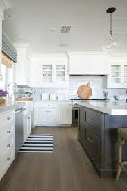 clic white kitchen hood design with cabinet doors for storage tongue groove cladded ceiling