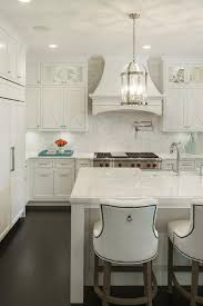 Off White Kitchen Features A Pair Of Round Edwardian Lanterns Illuminating  An Off White Kitchen Island Fitted With A Sink And Gooseneck Faucet Lined  With ...