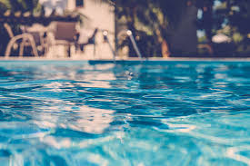swimming pool background. Blurred Surface View On Blue Swimming Pool Stock Photo Background B