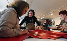 bea amblard master leather artisan center helps rosemary lanyon and louise comora with their