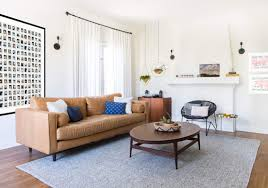 floor cushions instead of couch yellow wall art floor to ceiling window curtain white painted brick