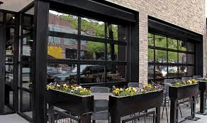 Glass garage doors restaurant Indoor Outdoor Commercial Garage Door Restaurant Glass Garage Doors Restaurant For Commercial Garage Doors For Restaurants Dakshco Garage Door Restaurant Fences Gate Garage Door Decoration