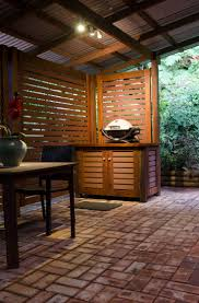 Recently built this BBQ area under our verandah. The horizontal slats on  the screen and