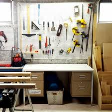 hang pegboard over a cement wall