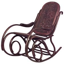 antique tho bentwood rocking chair image and candle