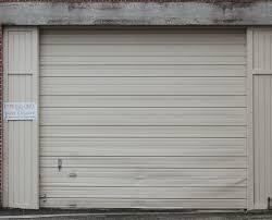 cream colored aluminum garage roll up door