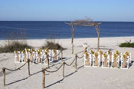 simply nature set up with sunflowers for florida beach wedding florida sun weddings