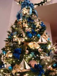 golden decorations and ribbon bows in blue color for christmas tree