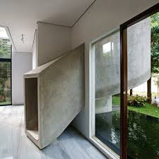 This cool concrete slide is in a home in Indonesia, and is by Aboday  Architects.