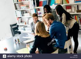 nice person office. Brainstorming By A Group Of People In Nice Office - Stock Image Person