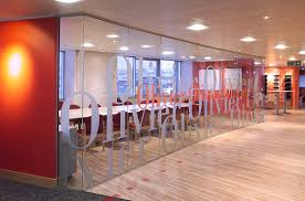 glass office wall. really like the use of lettering to make this glass wall look snazzy it allows office