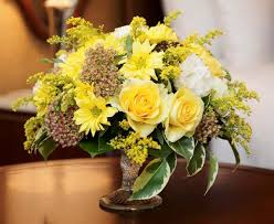 yellow flowers are welcoming centerpiece ideas for table decoration