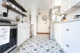 Mini wine racks hold up ceiling skimming shelves, a glass mixing bowl doubles as a fresh egg holder, and a water jug sidelines as cooking utensil storage. 20 Galley Kitchen Ideas Photo Of Cool Galley Kitchens Apartment Therapy