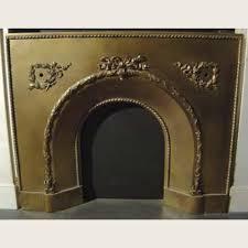 a victorian brass fireplace insert