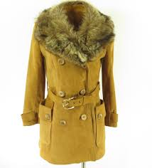 beautiful vintage jacket with a fluffy real fur collar possibly coyote complete with belt and an insulated liner this coat will keep you warm and stylish