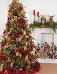 Christmas Tree Decorating Idea love the nativity set in the back!