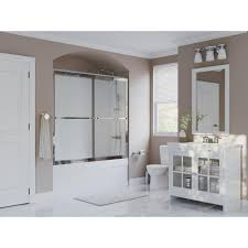 framed sliding tub door with towel bar in chrome and obscure glass