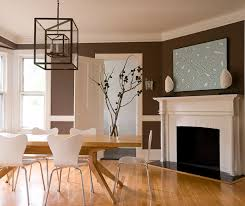 lovely modern dining room design with chocolate brown walls paint color chair rail mid century modern oak dining table white plastic modern chairs