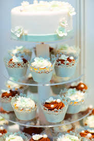 Wedding Cake And Cupcakes In Brown And Cream In Blue White And