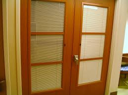 ie blinds used in a wood door with a metal lite kit and hard wood stops