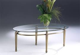 oval coffee table made of brass glass