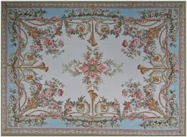 auvergne aubusson rug 9405cb has a blue outer field and a cream inner field with fl