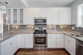 black granite countertops with tile backsplash. Busy Granite Countertops Backsplash Mosaic Tile With Ideas That Looks Good Kitchen White Black I