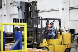 Worker Driving Forklift In Steel Industry Factory Stock Photo