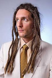 trendy white guy hairstyle with dreads