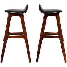 view this item and discover similar stools at pair of erik buch rosewood bar stools each on beautiful solid rosewood and original black