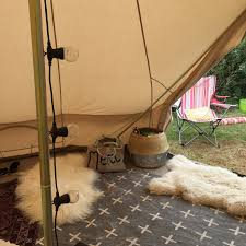 adding rugs immediately makes the tent look and feel cosy warm and homely