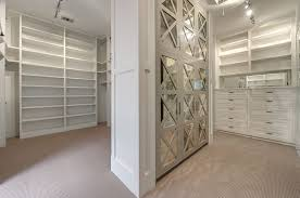 image mirrored closet. Fantastic Master Closet Features Gray Built-in Wardrobe Closets Accented With Mirrored Doors X Trim Across From A Dresser Under Image