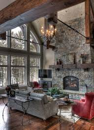 fearless living room decor rustic great room with stone fireplace and wall of windows