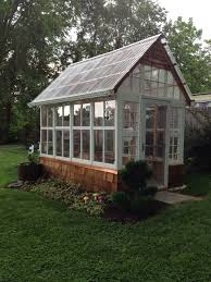 This is a 7'x12' greenhouse I made out of old windows from my