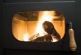 cleaning the glass door on your wood burner